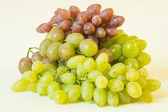 Grapes. Bunches of white and pink  on a white background Royalty Free Stock Photography