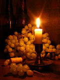 Grapes and candle. Still-life with bunches of grapes and candle stock image