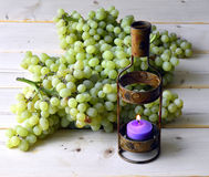 Grapes and candle. Royalty Free Stock Images