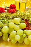 Grapes, champagne and gifts Stock Photography