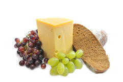 Grapes, cheese and bread Stock Photos