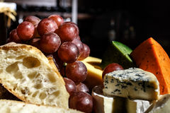 Grapes with cheese and bread royalty free stock image