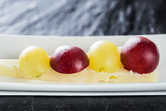 Grapes with cheese Royalty Free Stock Image