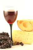 Grapes, cheese and a glass Stock Photos