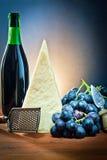 Grapes and cheese parmesan Stock Photo