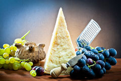 Grapes and cheese parmesan Stock Images
