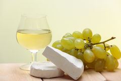 Grapes, cheese, and white wine Royalty Free Stock Photos