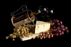 Grapes and cheese with wine Stock Images