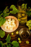 Grapes, cheese and wine still life Stock Photos