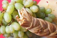 Grapes and cheeses Royalty Free Stock Photos