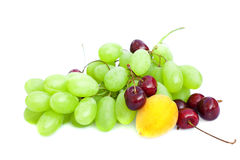 Grapes, cherries and apricots isolated on white Royalty Free Stock Photo
