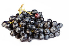 Grapes cluster on a white background Stock Images