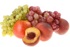 Grapes clusters, peaches and apple. Royalty Free Stock Photo