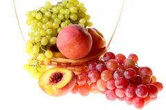 Grapes clusters, peaches and apple Royalty Free Stock Images