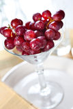 Grapes in a cocktail glass Royalty Free Stock Photos