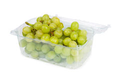 Grapes in the container Royalty Free Stock Photos