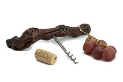 Grapes, corkscrew and cork Royalty Free Stock Photo