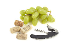 Grapes corkscrew and corks Stock Photos