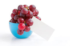 Grapes in cup. Grapes with a note to put the message you want Stock Photo