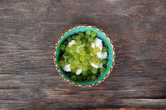 Grapes and curd cheese in ceramic bowl Stock Photo
