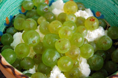 Grapes and curd cheese in ceramic bowl Royalty Free Stock Images