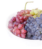 Grapes of different varieties - pink black and white on a white background Stock Photo