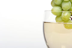 Grapes dipped into white wine Royalty Free Stock Images