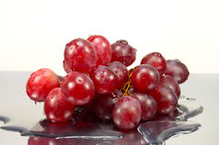Grapes in drops of water Royalty Free Stock Photos
