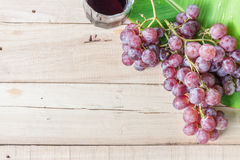 Grapes on dry wooden floor. Royalty Free Stock Images