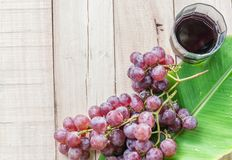 Grapes on dry wooden floor. Royalty Free Stock Photos