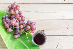 Grapes on dry wooden floor. Stock Photography