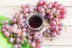 Grapes on dry wooden floor. Stock Photos