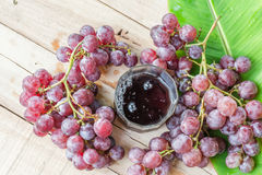 Grapes on dry wooden floor. Royalty Free Stock Photography