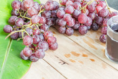 Grapes on dry wooden floor. Stock Image