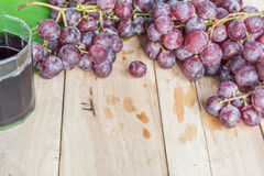 Grapes on dry wooden floor. Royalty Free Stock Photo