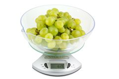 Grapes on the electronic balance Royalty Free Stock Photo