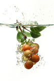 Grapes Falling into Water Stock Photography