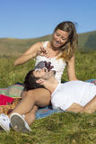 Grapes in girls hands feeding her boyfriend o a picnic Stock Image
