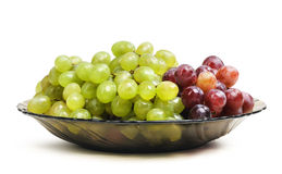 Grapes in a glass dish on white background Royalty Free Stock Photo