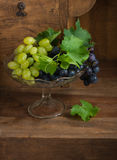 Grapes in glass vase Royalty Free Stock Image