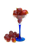 Grapes in a glass on a white background. Ripe grapes in a glass on a white background Royalty Free Stock Photo