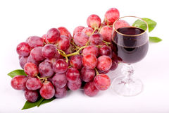 Grapes and a glass of wine royalty free stock photos