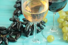 Grapes, a glass of wine autumn agriculture vintage rustic beverage on a blue wooden backgrounnut stock photography