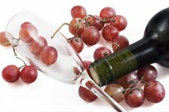 Grapes, glass and wine bottle Royalty Free Stock Image
