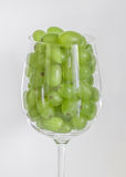 Grapes in a glass of wine. White grapes in a glass of wine Stock Photo