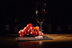 Grapes and glass of wine. On wooden table Stock Photography