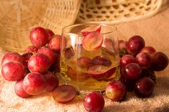 Grapes and grape juice in a glass Royalty Free Stock Photos