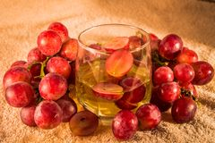 Grapes and grape juice in a glass Royalty Free Stock Photography