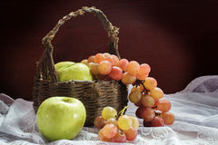 Grapes and green apple with old basket Stock Photography