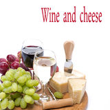 Grapes, hard cheese and two glasses of wine, isolated Royalty Free Stock Photography